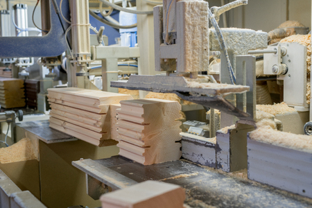 profiled: At sawmill. Image of profiled bar during processing, close-up Stock Photo