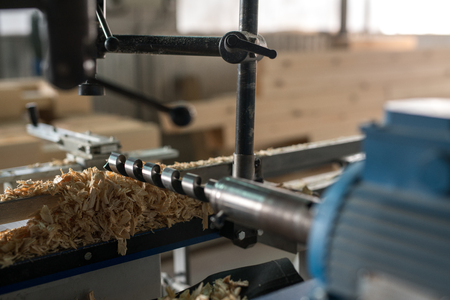 lumber industry: Image of machine tool with drill for woodworking, close-up