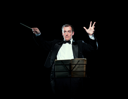 Studio photo of music director conducting with inspiration