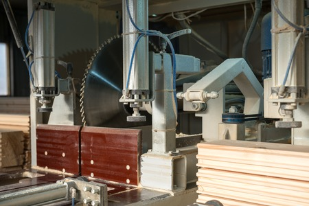 lumber industry: Image of machine for cutting the profiled bars, close-up
