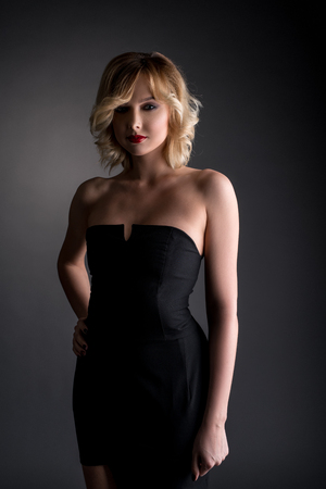 pretty dress: Studio photo of pretty blonde dressed in black cocktail dress