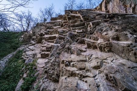 rock bottom: Bottom view on large rock with ledges. Tbilisi, Georgia