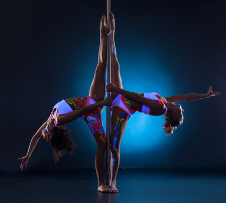 stripper pole  Flexible girls posing symmetrically doing gymnastic splits  Stock Photo. Stripper Pole Stock Photos   Pictures  Royalty Free Stripper Pole