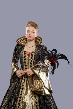 elizabethan: Full length portrait of young girl in carnival costume middle age with mask
