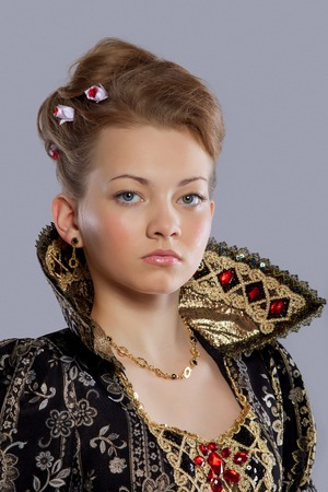 elizabethan: Studio portrait of young woman in carnival dress like princess