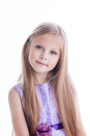 long hairs: Portrait of beautiful blonde little girl in purple dress with long hairs Isolated