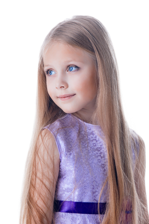 long hairs: Portrait of beautiful blonde little girl in purple dress with long hairs look aside isolated