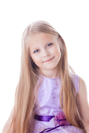 long hairs: Portrait of pretty blonde little girl in purple dress. Isolated on white