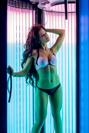 sunroom: Image of beautiful woman resting while tans in tanning booth