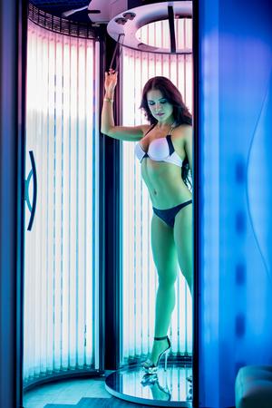 solarium: Image of beautiful woman sunbathing in solarium