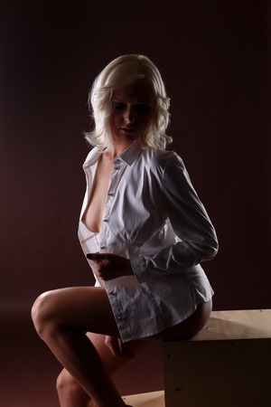 nude blonde girl: Image of sexy blonde wearing blouse over her naked body