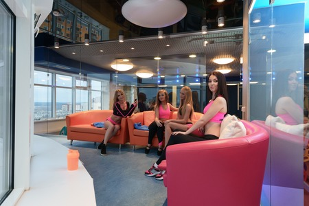 recreation room: Attractive girls posing in recreation room at gym Stock Photo