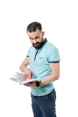 brunets: Image of bearded man looks at camera while shows the book Stock Photo