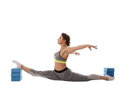 female gymnast: Image of female gymnast exercising using gymnastic bricks