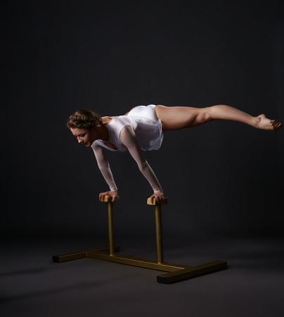 acrobat: Beautiful female acrobat training on circus stands Stock Photo