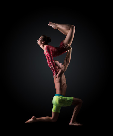 acrobatic: Image of young athletes perform acrobatic support Stock Photo
