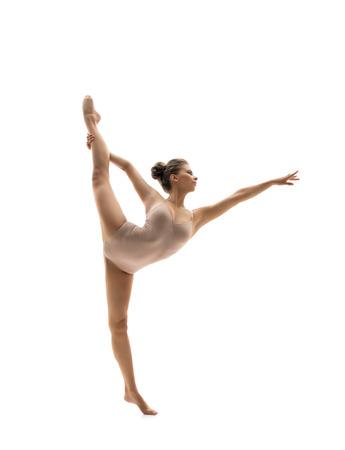 gymnastique: Graceful dancer performs vertical gymnastic split. Isolated on white Banque d'images