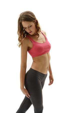 mujer deportista: Foto del estudio de la hembra atractiva atleta posando de pie Foto de archivo