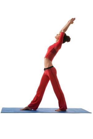 harmonous: Studio photo of harmonous young woman practicing yoga Stock Photo