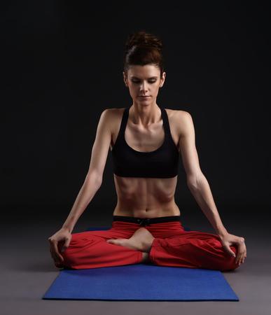 breathing exercise: Yoga in studio. Image of woman doing breathing exercise