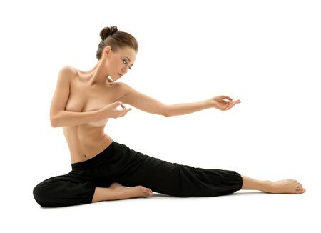 nude yoga: Photo of topless woman practising yoga in studio