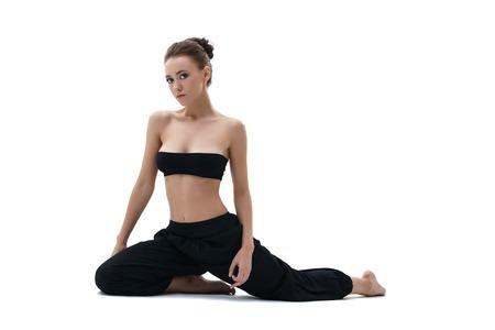 Yoga. Studio photo of beautiful girl sitting. Isolated on white background Stock Photo