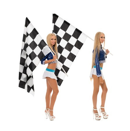 Sexy girls posing with flags. Concept of race. Isolated on white background