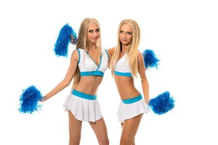 pom poms: Support team. Studio image of pretty girls with pom poms