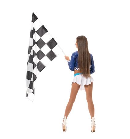 Achteraanzicht van de langbenige brunette poseren met geruite vlag Stockfoto