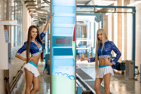 two car garage: Beautiful young girls advertise modern car wash