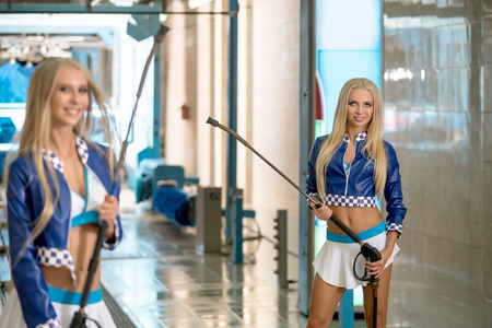 two car garage: Image of sexy blond models advertise modern car wash