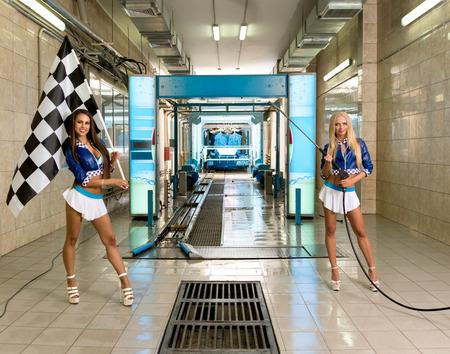 Image of sexy girls posing at vehicle maintenance station