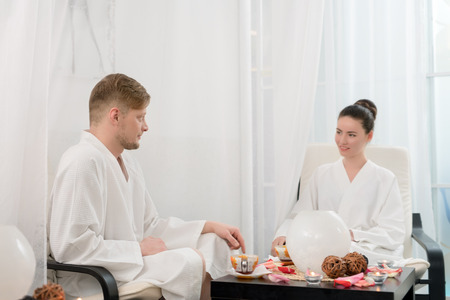 couple relaxing: Photo of attractive man and woman relaxing in spa salon