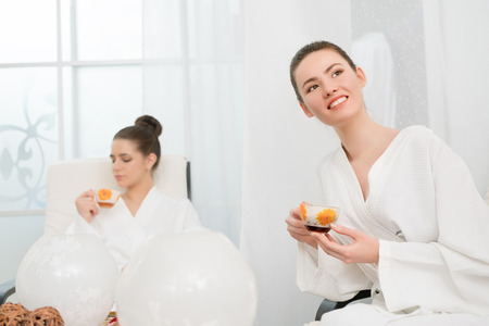spa woman: Image of beautiful young girls relaxing in spa salon Stock Photo
