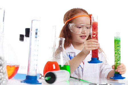 experimenter: Image of surprised little experimenter in studio, close-up