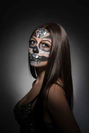 pretty face: Santa Muerte. Image of pretty young woman with face art Stock Photo