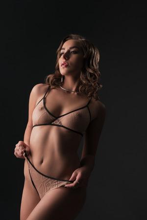 nude young girl: Erotica. Beautiful young woman posing in stylish underwear