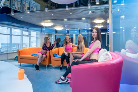 recreational area: Beautiful girls posing in recreational area of gym Stock Photo