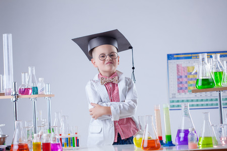experimenter: Funny boy posing as chemist in chemical laboratory, close-up