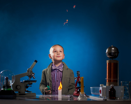 experimenter: Curious experimenter watching flying fire in lab, close-up Stock Photo