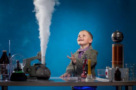 Image of joyful boy watching reagent evaporation, close-up