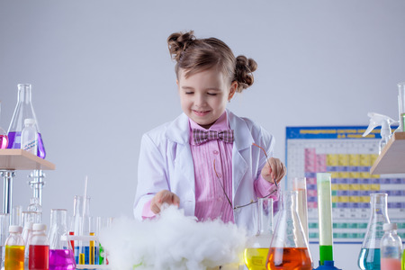 conducted: Smiling chemist successfully conducted experiment in lab Stock Photo