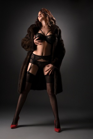 black women naked: Well shaped girl in lacy underwear, stockings, red high heel shoes and unbuttoned fur coat posing sexually and gracefully in studio