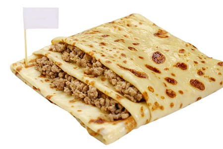 forcemeat: Pancake in a form of a pocket stuffed by forcemeat white background close up view Stock Photo