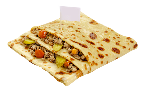 forcemeat: Pancake in a form of a pocket stuffed by forcemeat with vegetables and greenery white background close up view Stock Photo