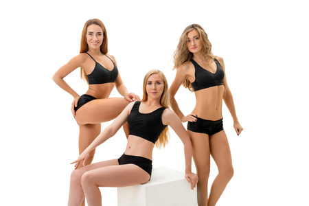 Slim girls posing in sexy slinky black sportswear