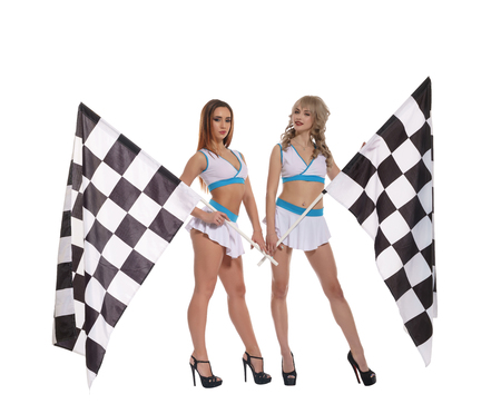 Women in uniform with checkered race flags