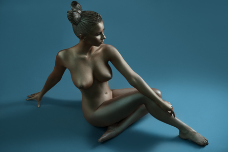 woman naked body: Naked model covered with silver bodyart paint Stock Photo