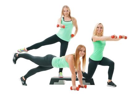 gracefully: Slim sportswomen in tops and leggings pose in studio Stock Photo