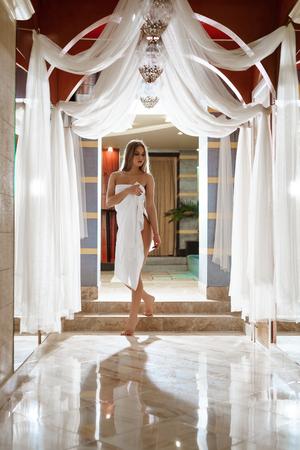 Sexy blonde shot in luxurious sauna interior